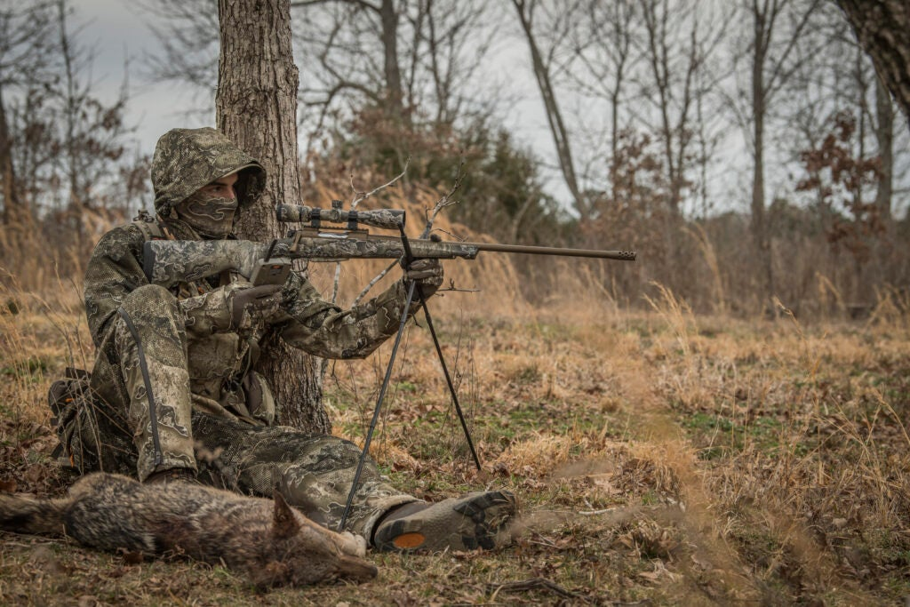 coyote hunter shooting a rifle