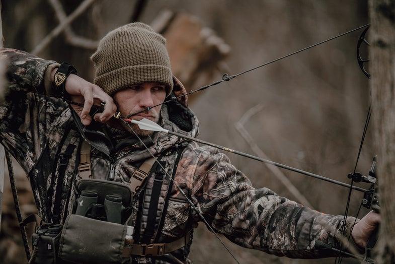 Levi Morgan shooting a bow
