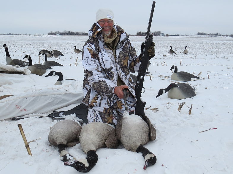 canadian goose hunter in the snow