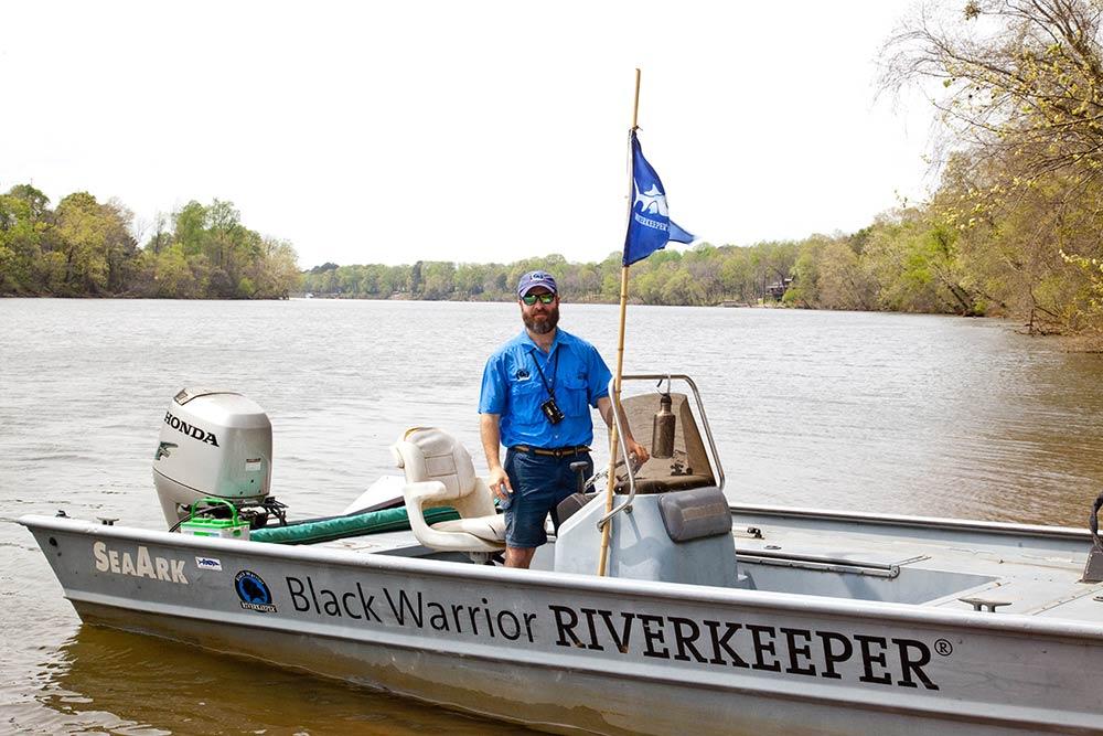 nelson brook in a black warrior riverkeeper patrol boat