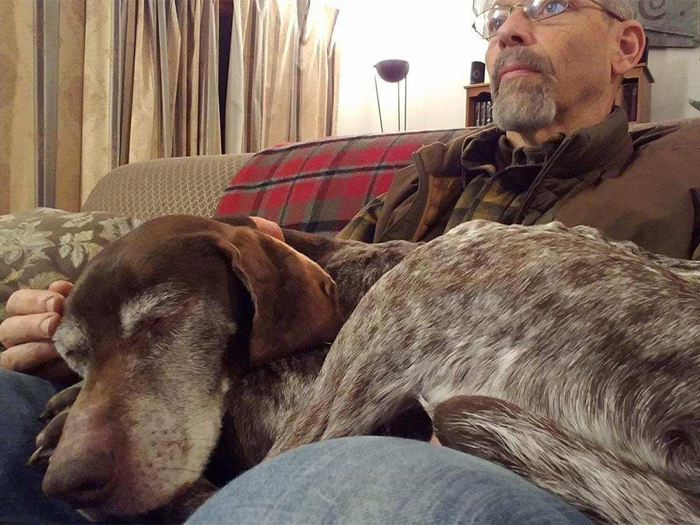 phil bourjaily with a hunting dog in his lap