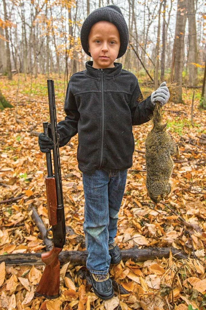 young child hunting fox squirrel