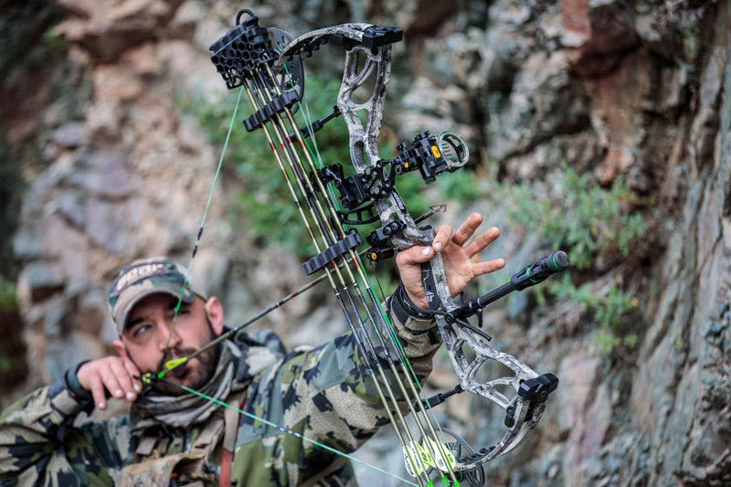 bowhunter drawing back on bear archery compound bow