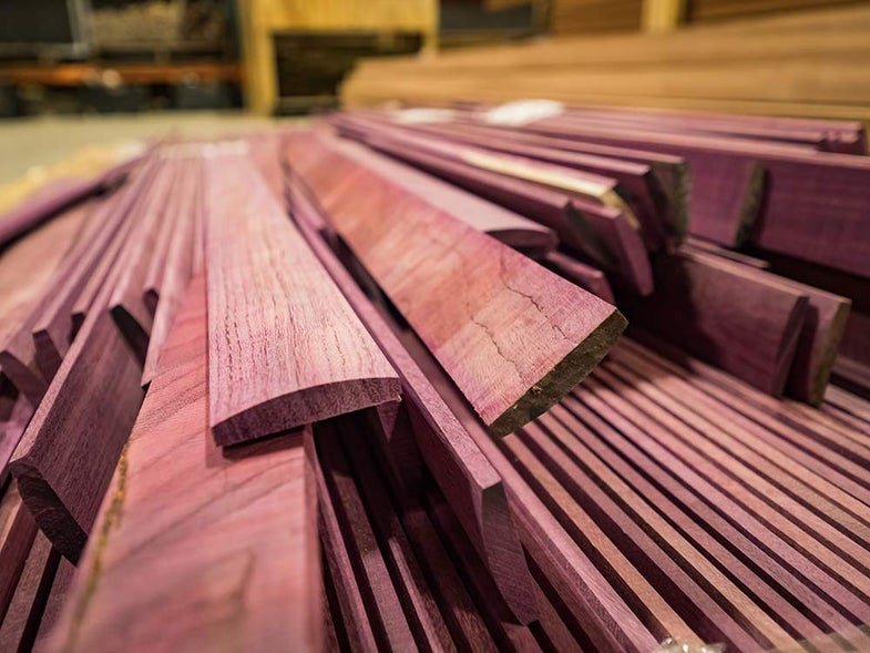 a stack of purple heartwood used to make turkey box calls