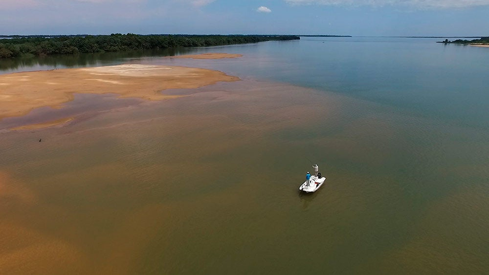 a drone image of a small boat on the upper parana river