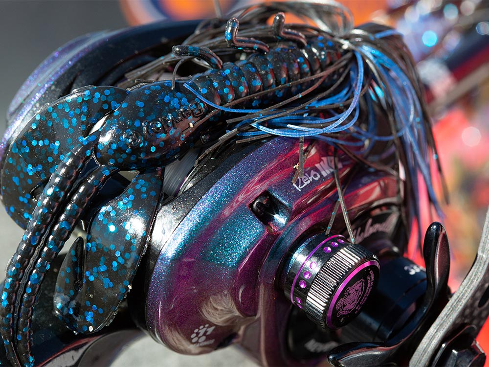 reel with black and blue jig lure