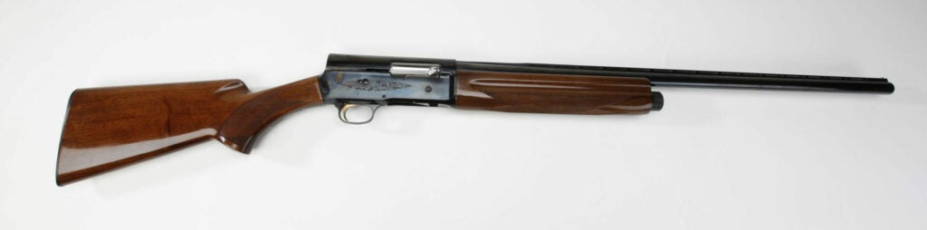 A Browning Auto 5 rifle on a white background.