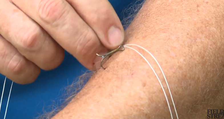 Video: How to Remove a Fish Hook From Your Arm
