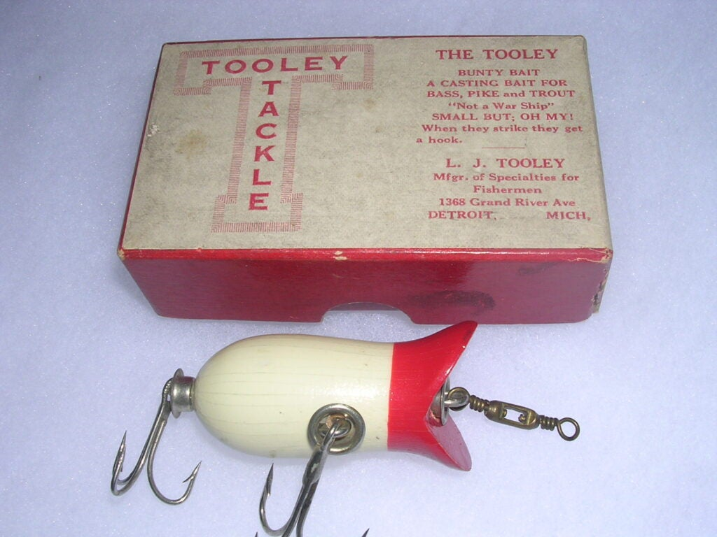 L.J. Tooley of Chicago was a world champion baitcaster who marketed lures in the early teens.