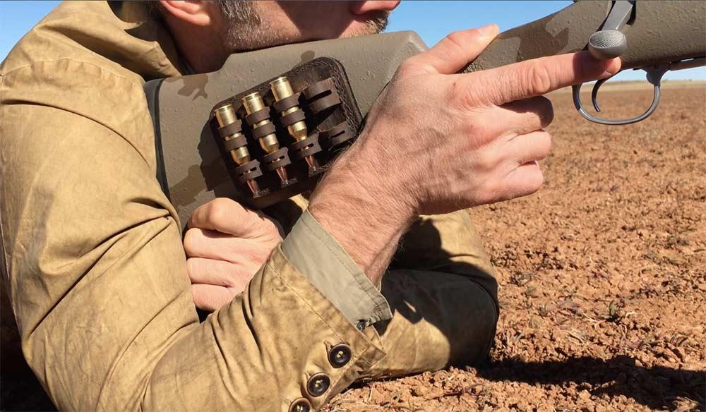 shooter resting rifle buttstock on shoulder