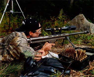 John Â¿Â¿Yenason prepares to fire the .50-caliber LAR Grizzly Big Boar, which weighs more than 30 pounds.