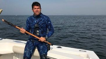 yuri krainov spearfisher sittin on boat