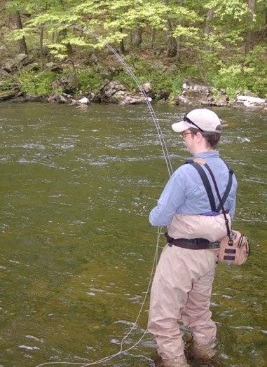 a man fishing a stream