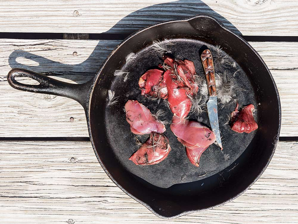 rail bird meat in a cast iron skillet