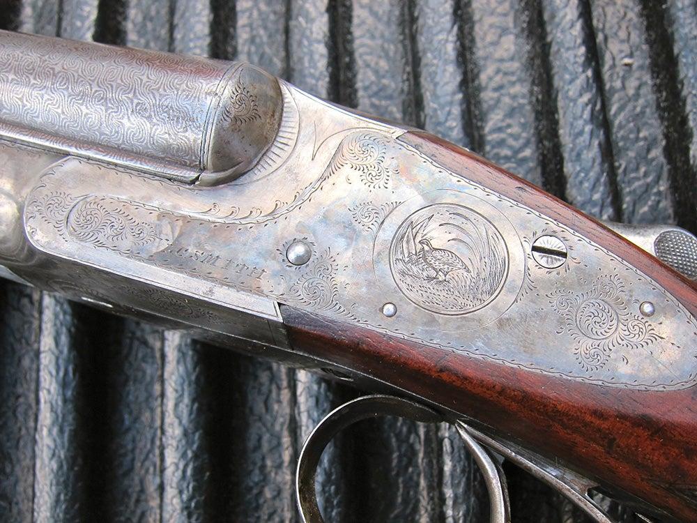 engraved quail adorning the receiver