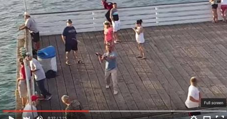 Angry Angler Tries To Reel In Drone