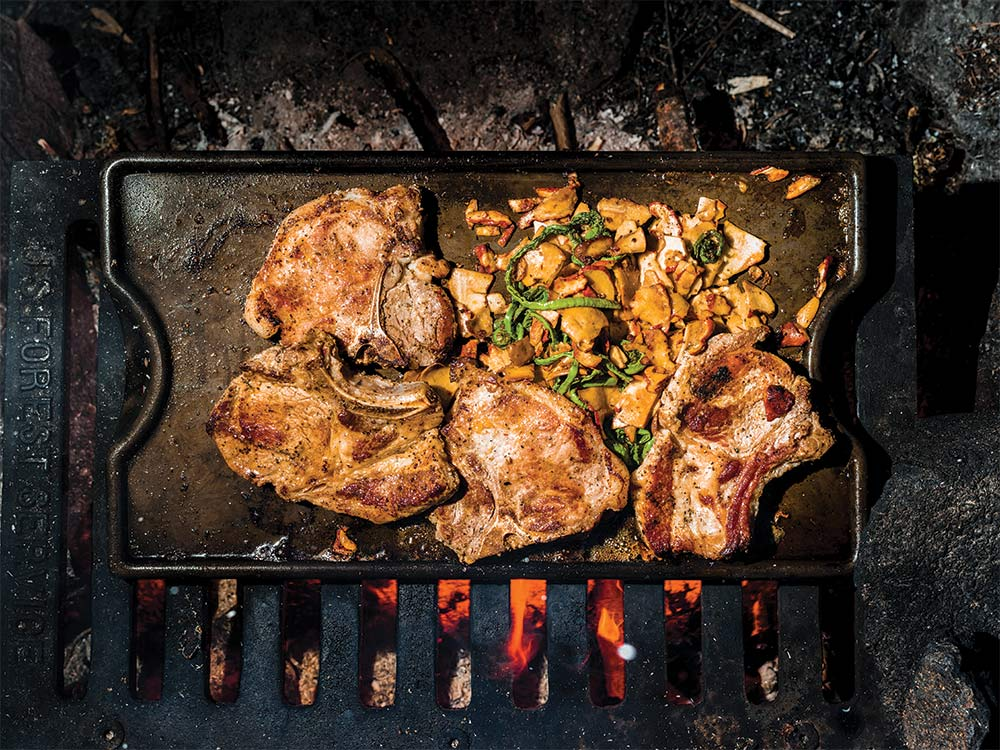 chops over campfire