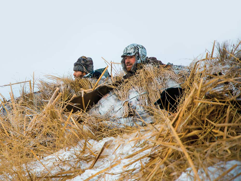 two hunters in snow blind