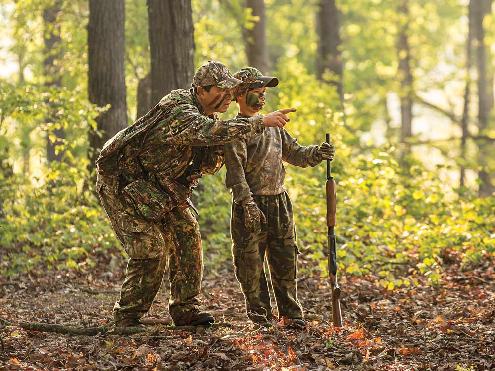 father teaching son hunting lessons