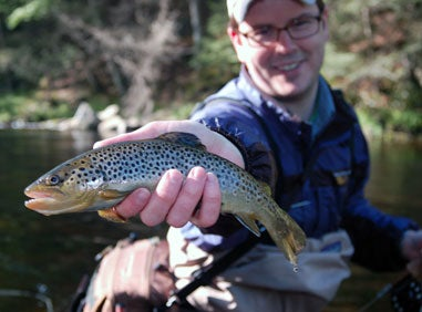 man holding up a trout