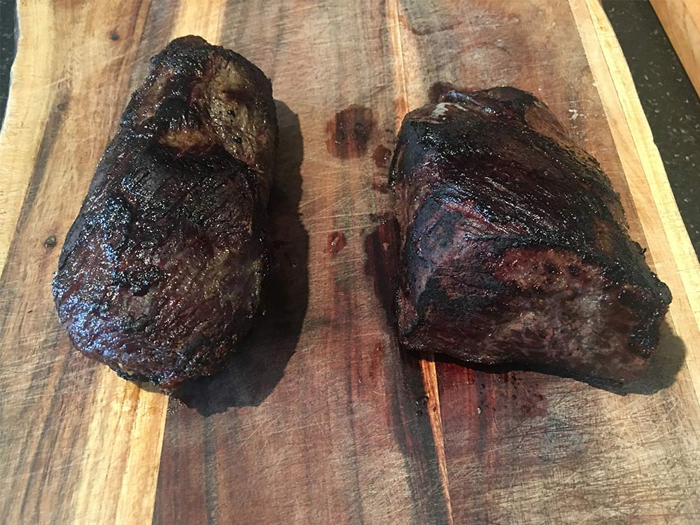 Cooked dry-aged wild game steaks come to a rest