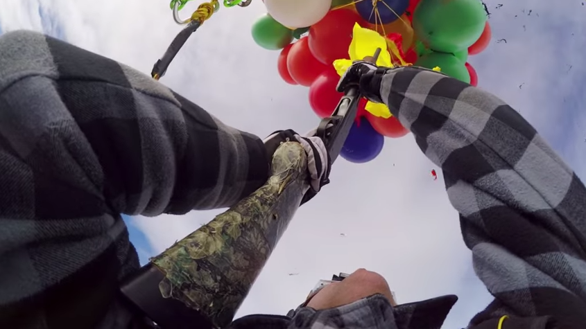 Video: Skydiver in Flying Lawn Chair Shoots Himself Down with a Shotgun