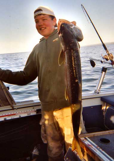 Ryan Voss, 12, caught this 34-inch, 9-pound laker while fishing with his father on Lake Superior.