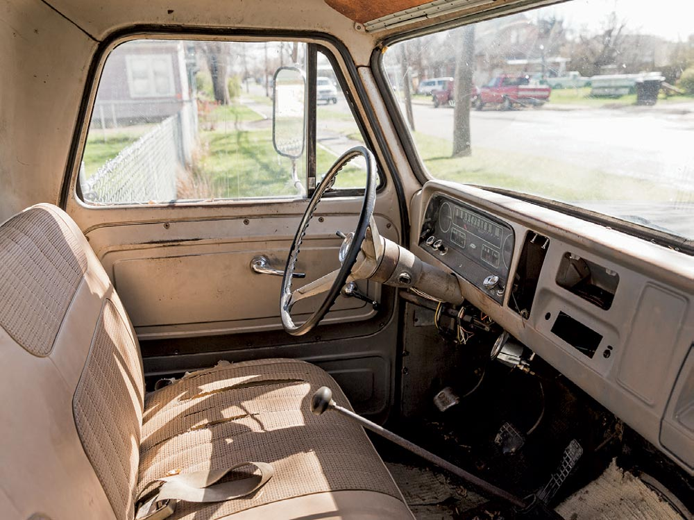 Inside of a truck with a stick shift
