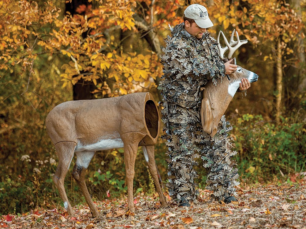 Hunter setting up a buck decoy