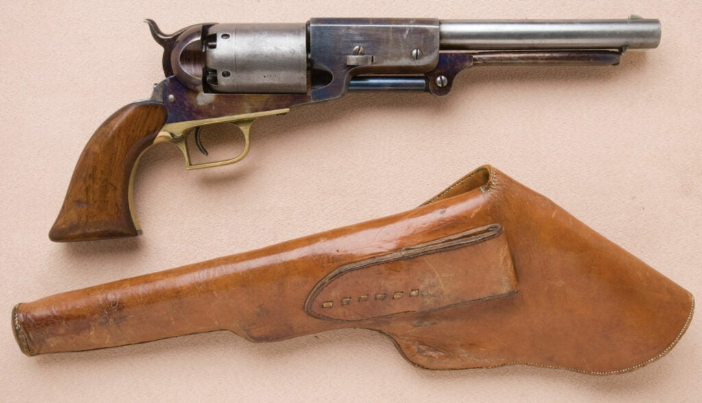 httpswww.fieldandstream.comsitesfieldandstream.comfilesimport2014importImage2011photo38356Fine_and_Exceptional_Colt_Walker_Model_Civilian_Series_Revolver_with_Period_Flap_Leather_Holster_Known_as_the_The_Thumbprint_Walker_-_1.jpg