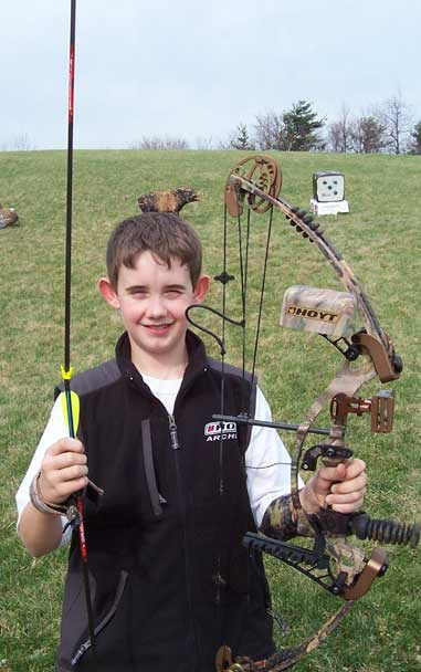 Gage Snider, 12, was shooting his new bow when he heard a sound he hadn't before. He went to the target and found that his last shot didn't hit the target, but his previous shot.