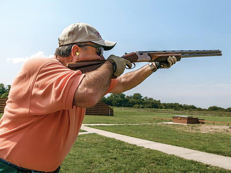 man shooting skeet duck training