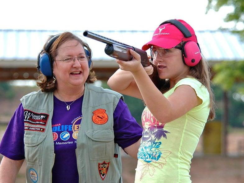 girl trap shooting shotgun