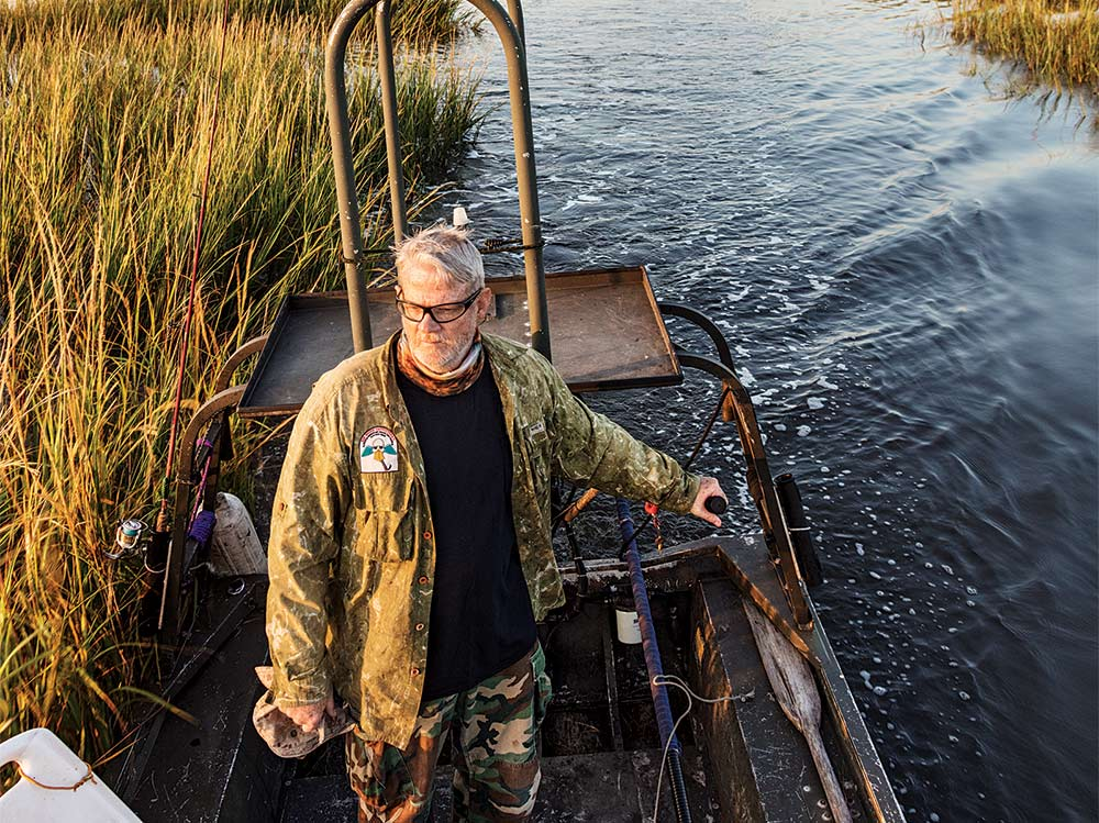 guide navigating marshes in a john boat