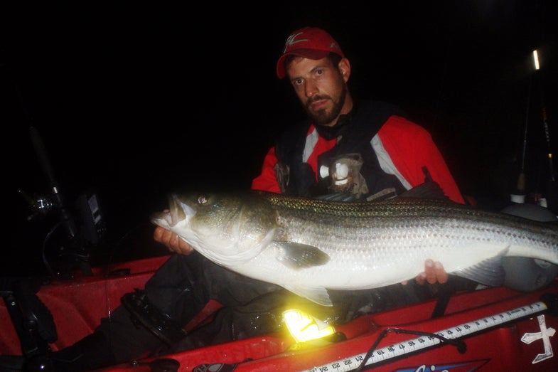 Photos: Kayak Fisherman Catches Prize-Winning 51-Inch Striper as Storm Rolls In