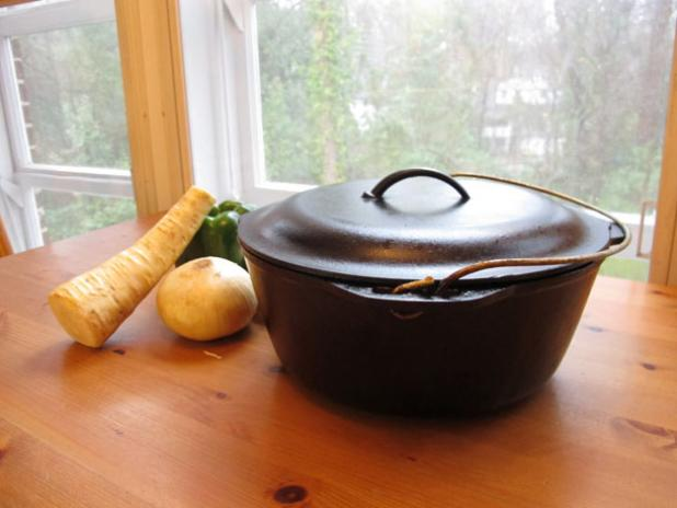The fully restored cast iron dutch oven, ready to cook a meal.