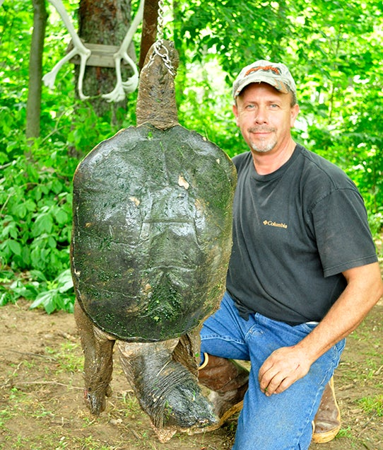 How an Expert Trapper Catches Huge Snapping Turtles in Indiana