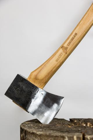 allagash cruiser axe in a wooden stump