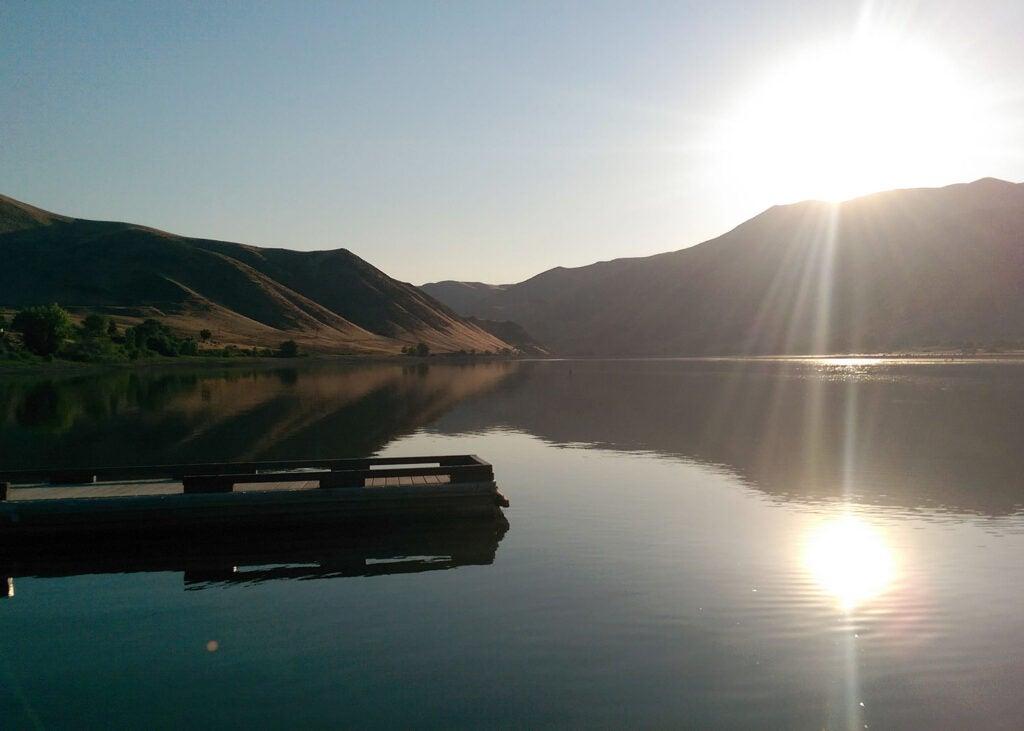 A lone dock on a lake bluff