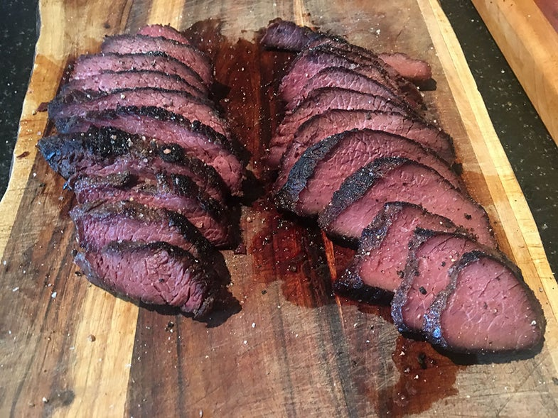 Cooked dry-aged wild game steaks ready for eating