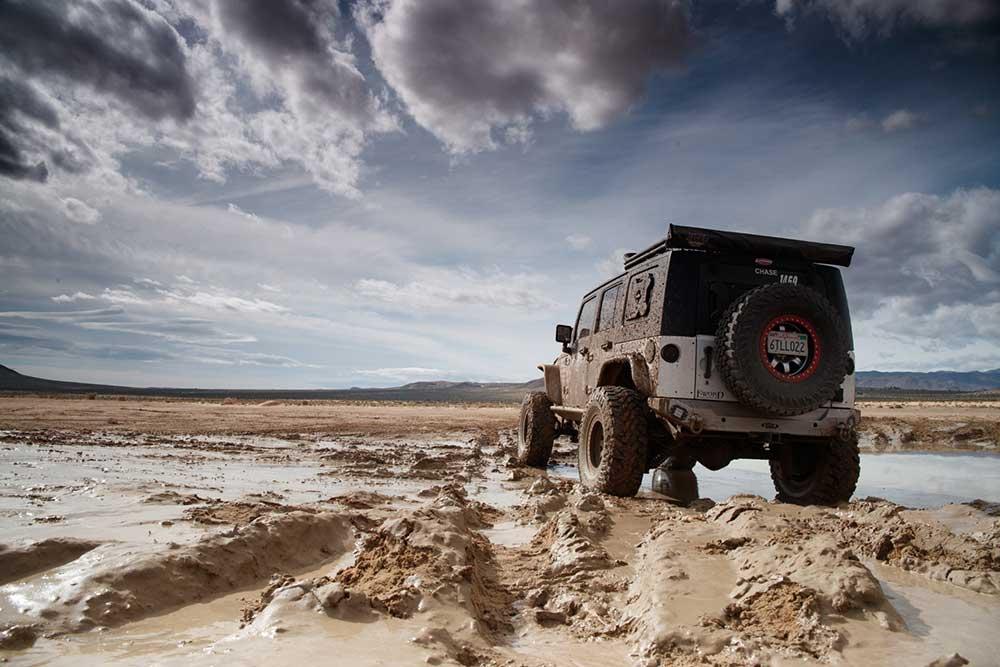 jeep riding through mud