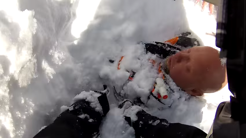 Video: Helmet-Cam Footage of Snowmobiler Buried by Avalanche and Rescued