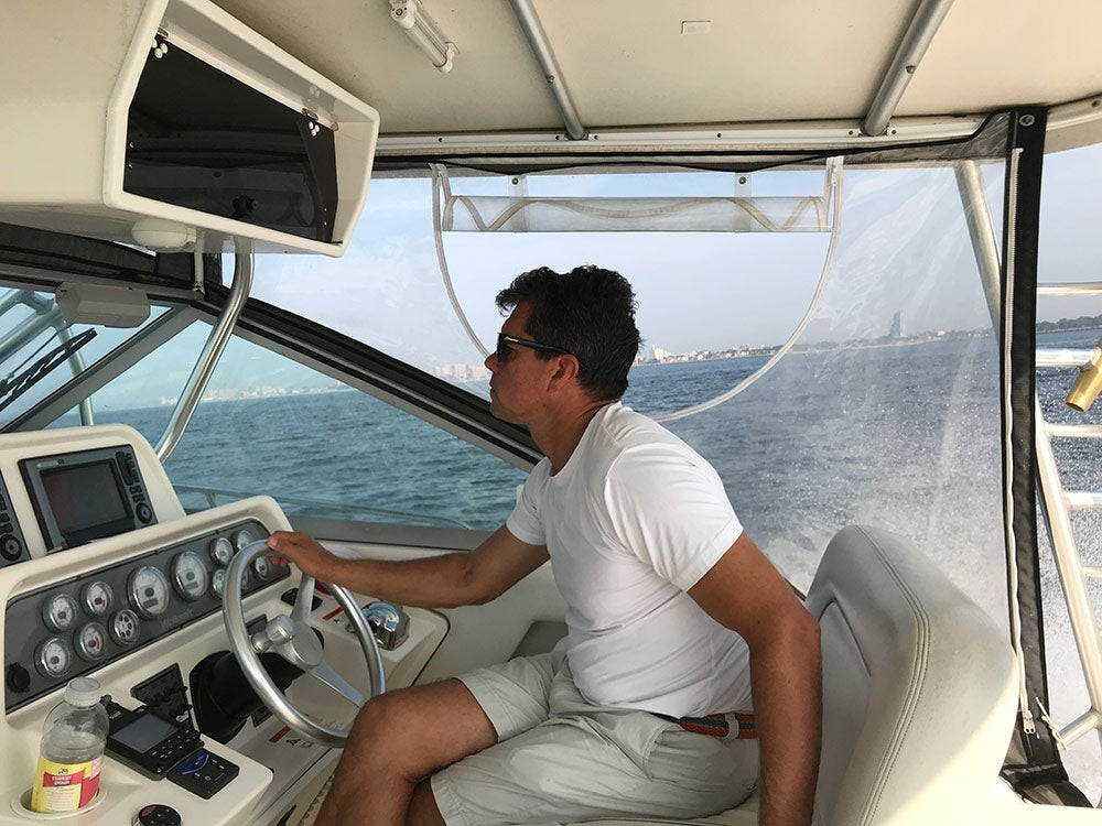 yuri krainov piloting fishing boat