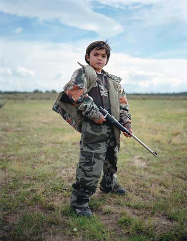 kids with guns and the animals they killed with those rifles and shotguns and pistols are the young hunters who make up the future of deer and big game and small game and waterfowl and bird hunting
