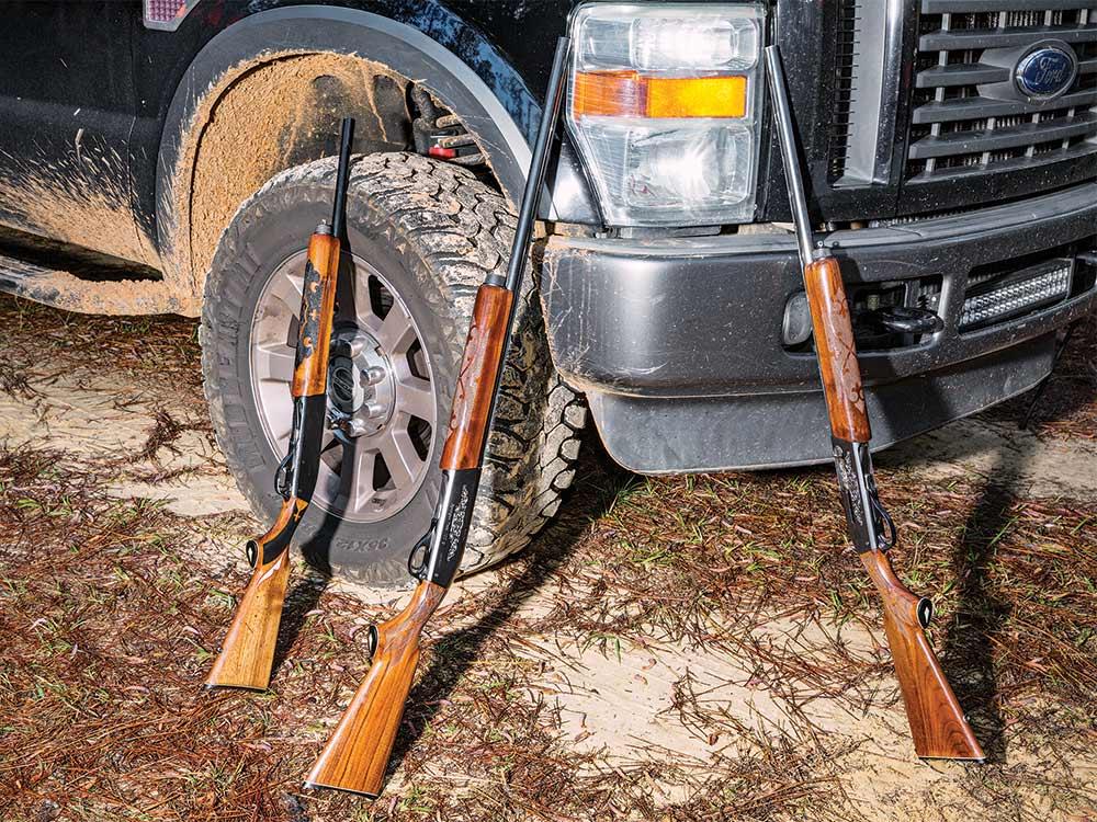 shotguns leaning against truck