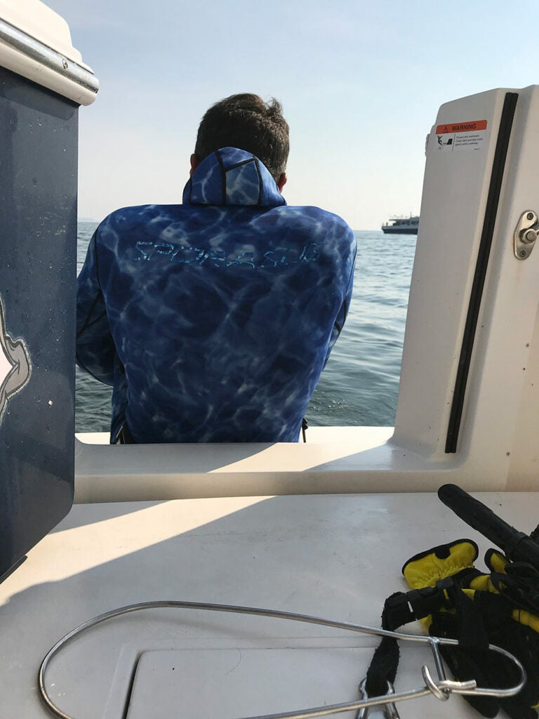 Yuri Krainov sitting boatside