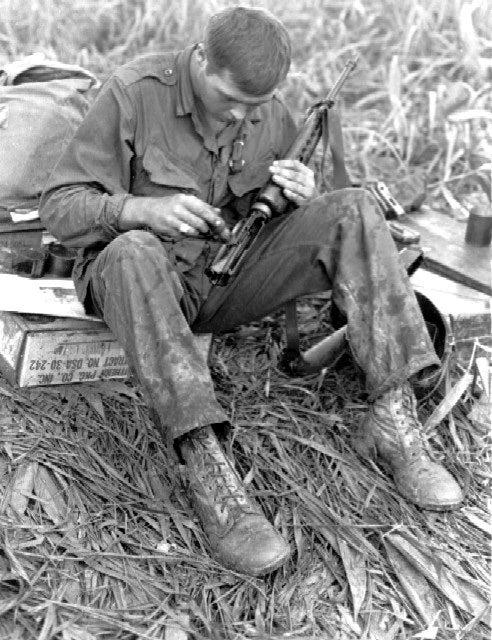 united states soldier cleans M16 vietnam war