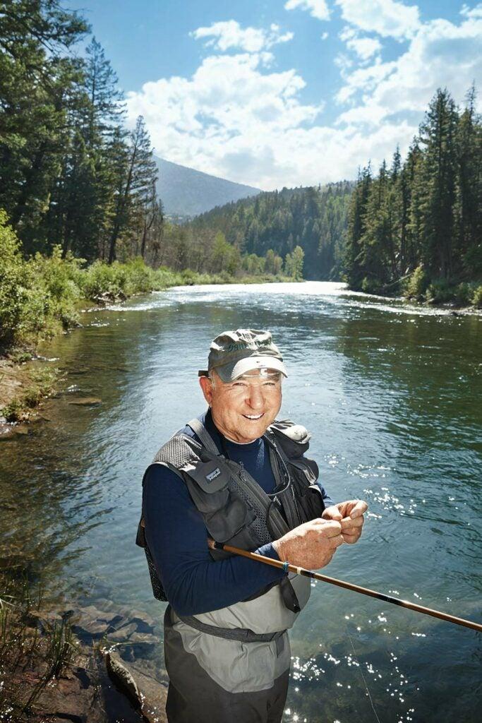 yvon chouinard changing the fly on his tenkara fishing rod