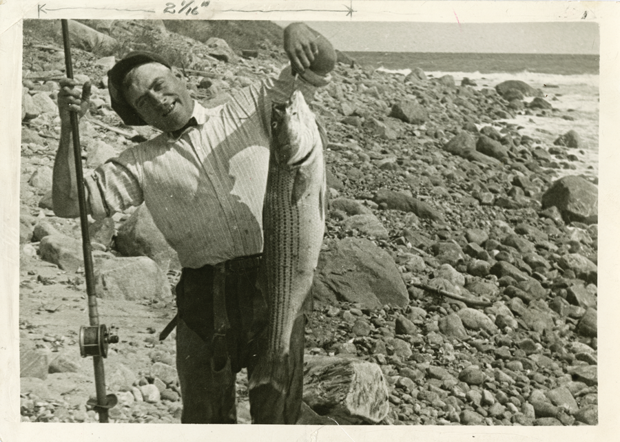 A black and white image of a northeast angler fishing striped bass.