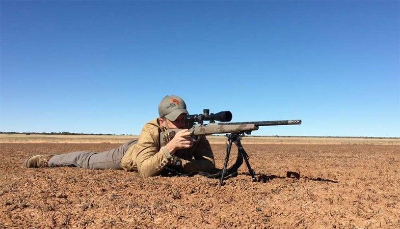 a shooter aiming long range rifle